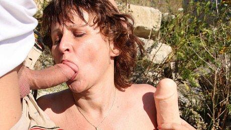 Hairy mature slut fucked in the open air