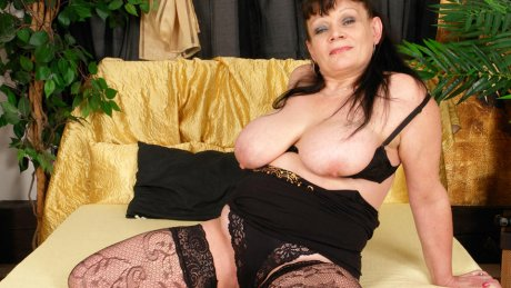 Big titted mama playing with a toy