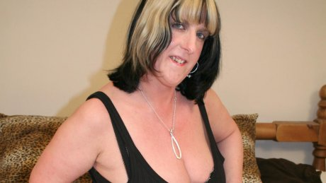 Big titted mature slut playing with herself