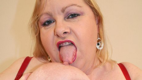 Big mama playing with her huge tits and pussy