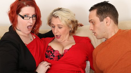 Two busty British housewives share their toyboy's cock in hot threesome