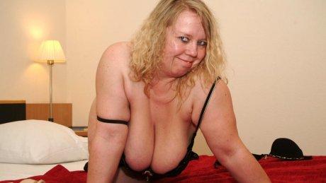 This naughty german cougar shakes her big tits