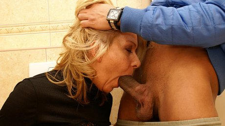 She licks ass, fucks and sucks on a public toilet