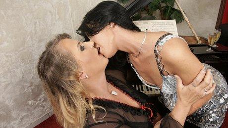 Hot babe licking a mature lesbian