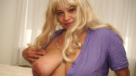 Blonde big titted mama getting wet on her bed