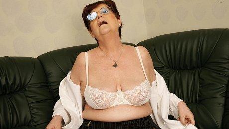Horny mature masturbating slut with a dildo