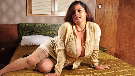 Huge breasted Latin mature Bra buster gets wet