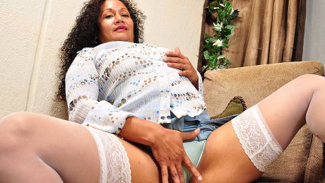 This horny Latin housewife loves to play with her hairy pussy