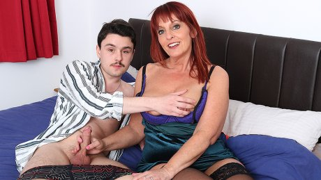 This naughty cougar loves to suck and fuck the cock from her toy boy