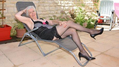 Horny British mature lady getting wet in her garden
